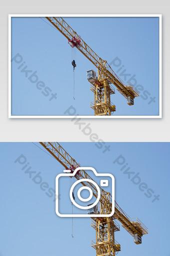 藍天黃色塔式起重機施工工作攝影圖片 攝影圖 模板 JPG