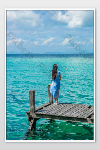 Back view photography picture of beautiful woman on wooden trestle bridge in Sabah Beach, Southeast Asia Photo Template JPG