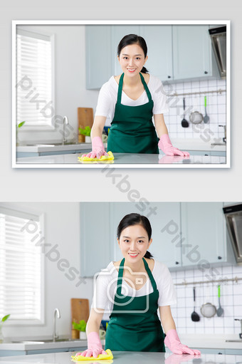 Young housewife, housekeeping service, wipes the desktop with a rag Photo Template JPG
