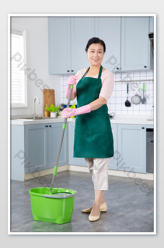 Kitchen housewife housekeeping service in the kitchen doing hygiene Photo Template JPG
